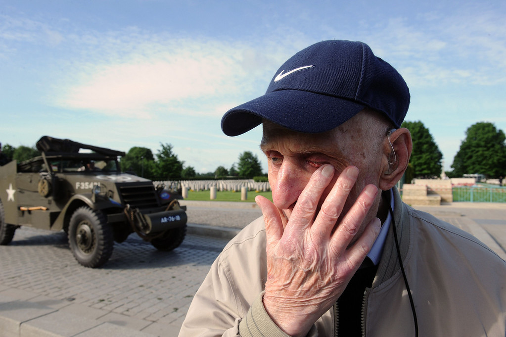 . British World War II veteran Harry Humphreys, 92, from the 4th Royal Dragon Guard, reacts after his visit at Bayeux\'s war cemetery, while an old allied military vehicle passes by, in northern France, on June 5, 2014, a day before the start of the D-Day commemorations.  AFP PHOTO / JEAN FRANCOIS MONIER/AFP/Getty Images