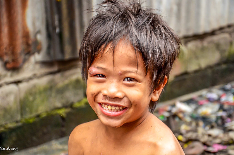 Smiling boy with dirty face