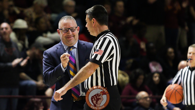 Head coach Buzz Williams smiles while talking with referee Pat Driscoll in the second half. (Mark Umansky/TheKeyPlay.com)