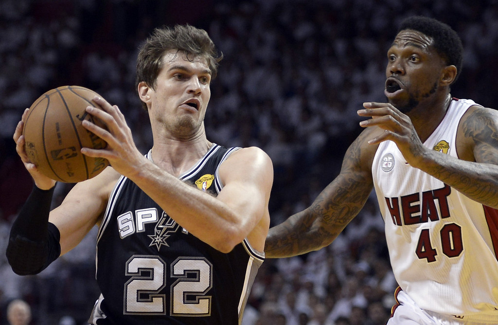 . Tiago Splitter (L) of the San Antonio Spurs is guarded by  Udonis Haslem (R) of the Miami Heat during the first half of Game 2 of the NBA Finals at the American Airlines Arena June 9, 2013 in Miami, Florida. BRENDAN SMIALOWSKI/AFP/Getty Images