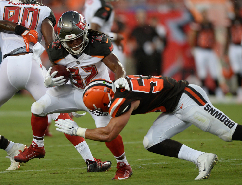 . Tampa Bay Buccaneers running back Jacquizz Rodgers is hit by Cleveland Browns outside linebacker Joe Schobert during the first quarter of an NFL preseason football game Saturday, Aug. 26, 2017, in Tampa, Fla. (AP Photo/Jason Behnken)
