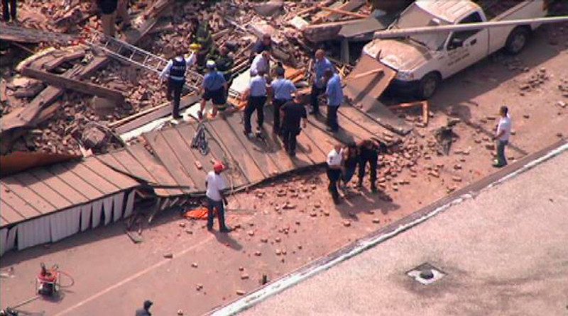 . Rescue workers search through rubble following a building collapse as seen in this aerial still image taken from video courtesy of NBC10.com, in Philadelphia June 5, 2013.  REUTERS/NBC10.com/Handout via Reuters