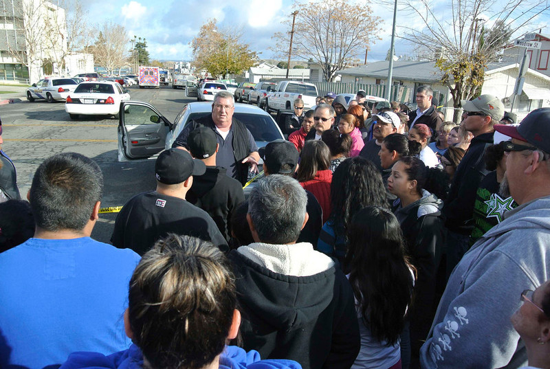 . Taft Police Chief Ed Whiting speaks to concerned parents after a shooting at Taft Union High School in Taft, California January 10, 2013.  Gunfire erupted on Thursday at a California high school in inland Kern County in a shooting in which two people were injured, county officials said, and media reports indicated the assailant had been arrested.  REUTERS/Michael Long/The Taft Independent
