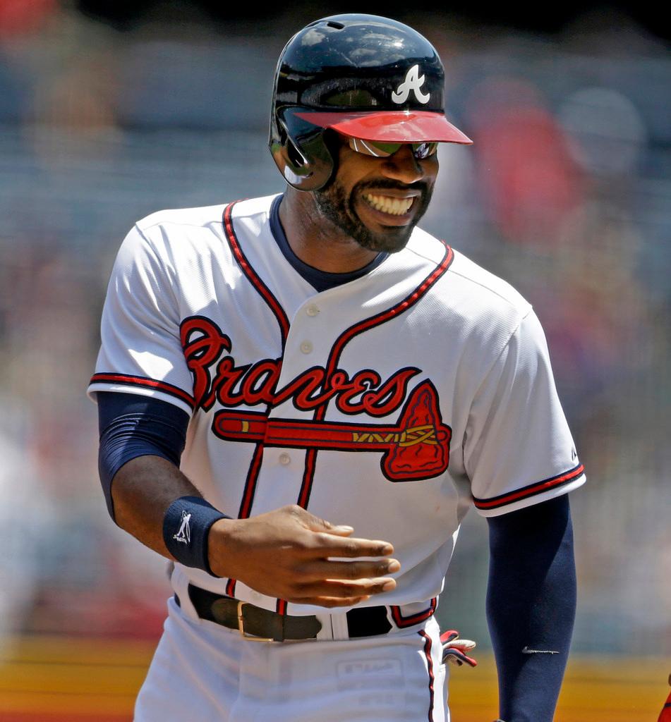 . Atlanta\'s Jason Heyward smiles after hitting a single to score teammate Jordan Schafer in the first inning. (AP Photo/David Goldman)