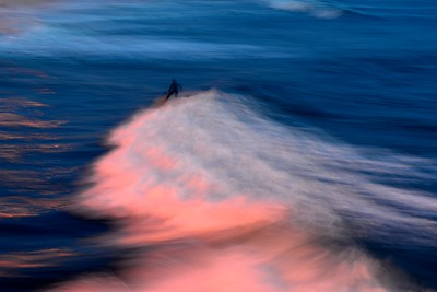 A Surfer Dropping In at Dusk- Oceanside Pier, California.