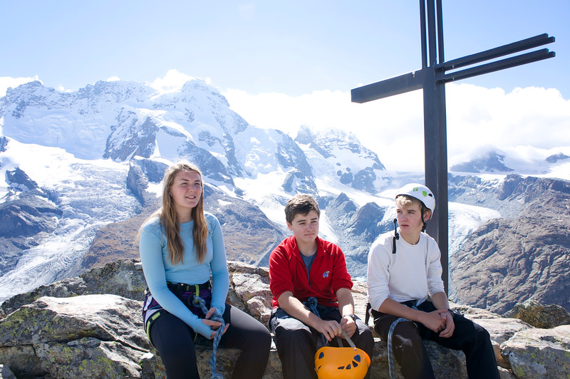 Ema, Brett, and Rives at the top of Riffelhorn with Breithorn in the background