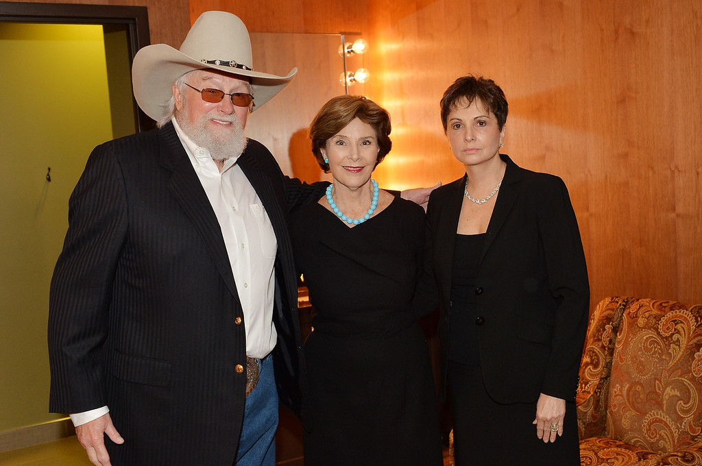 . (L-R) Country musician Charlie Daniels, former US First Lady Laura Bush, and Nancy Jones attend the funeral service for George Jones at The Grand Ole Opry on May 2, 2013 in Nashville, Tennessee.  (Photo by Rick Diamond/Getty Images for GJ Memorial)