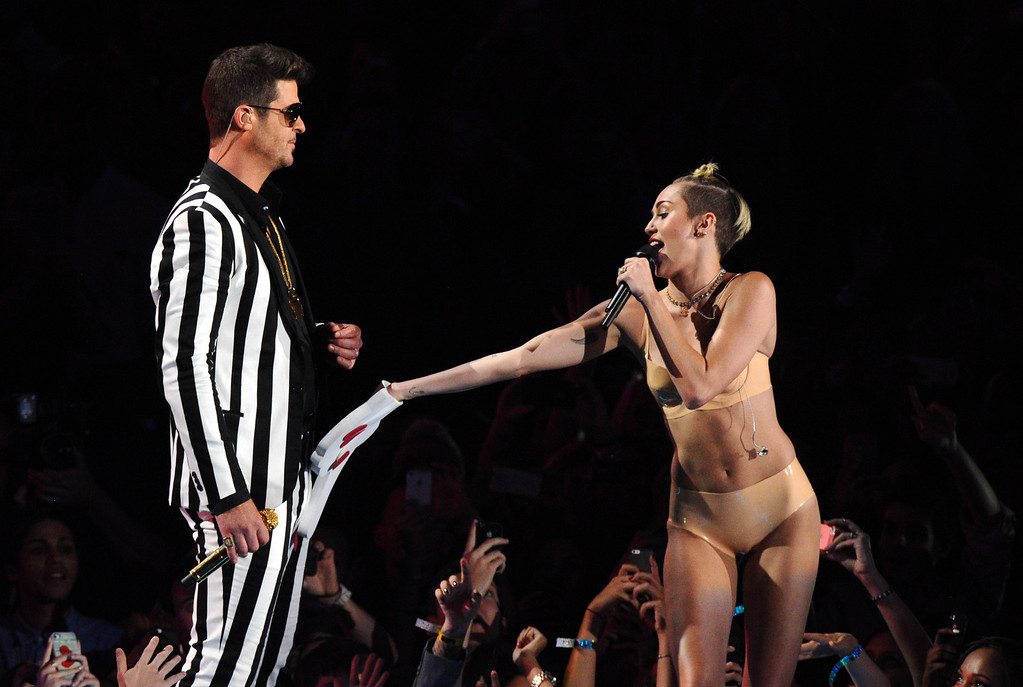 """. Robin Thicke, left, and Miley Cyrus perform \""""Blurred Lines\"""" at the MTV Video Music Awards on Sunday, Aug. 25, 2013, at the Barclays Center in the Brooklyn borough of New York. (Photo by Charles Sykes/Invision/AP)"""