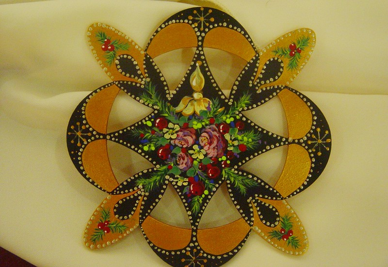 intricate wooden hand painted Christmas decoration.jpg
