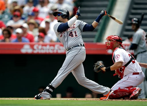 . Detroit Tigers\' Victor Martinez (41) hits an RBI-double during the first inning of a baseball game against the Los Angeles Angels on Sunday, July 27, 2014, in Anaheim, Calif. (AP Photo/Jae C. Hong)