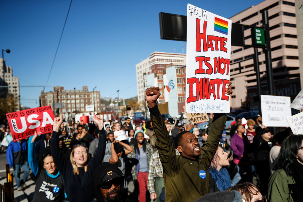 . Protestors march through downtown after a mistrial is declared due to a hung jury in the murder trial against Ray Tensing, Saturday, Nov. 12, 2016, in Cincinnati. Tensing, a white former University of Cincinnati police officer, was charged with murder in the shooting of Sam DuBose, an unarmed black motorist, while on duty during a routine traffic stop on July 19, 2015. (AP Photo/John Minchillo)