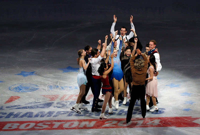 . The U.S. Olympic figure skating team headed to Sochi do a group cheer on mid-ice at the end of their skating spectacular after the U.S. Figure Skating Championships in Boston, Sunday, Jan. 12, 2014. (AP Photo/Elise Amendola)