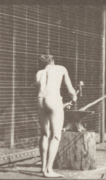 Man in pelvis cloth hammering an anvil