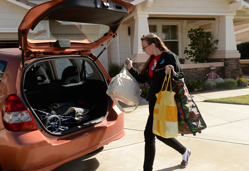 . Amanda Hartrell loads up her vehicle as she prepares to evacuate from her home on Ridge View Drive in Azusa on Thursday February 27, 2014. (Staff Photo by Keith Durflinger/San Gabriel Valley Tribune)