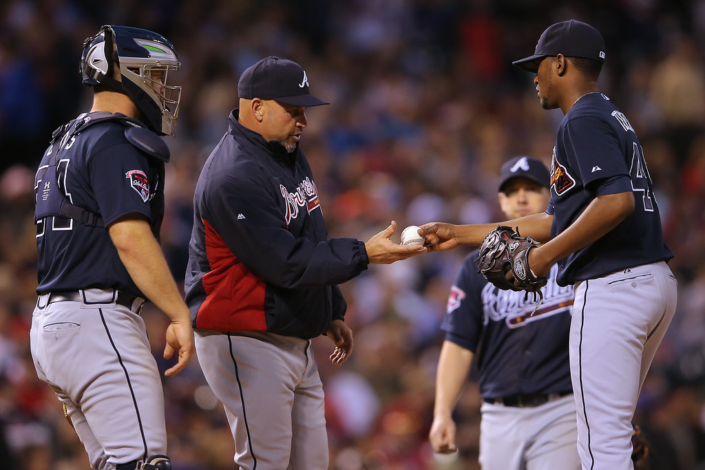 . Manager Fredi Gonzalez #33 of the Atlanta Braves removes starting pitcher Julio Teheran #49 of the Atlanta Braves from the game against the Colorado Rockies in the seventh inning at Coors Field on June 11, 2014 in Denver, Colorado.  (Photo by Doug Pensinger/Getty Images)