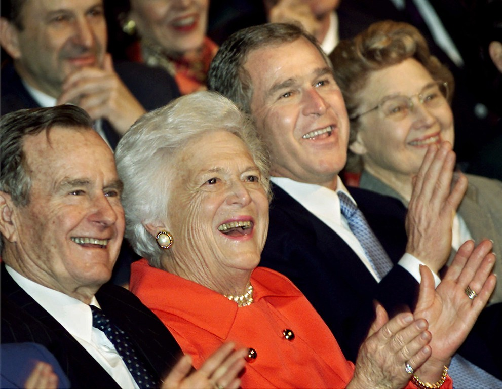 . From left: former President Bush, Barbara Bush, President-elect Bush, and Jenna Welch, Laura Bush\'s mother, watch from the front row at the Daughter\'s of the American Revolution Constitution Hall as Laura Bush, not seen, headlines an event for her husband\'s presidential inaugural celebration, in Washington Friday, Jan. 19, 2001. (AP Photo/J.Scott Applewhite)