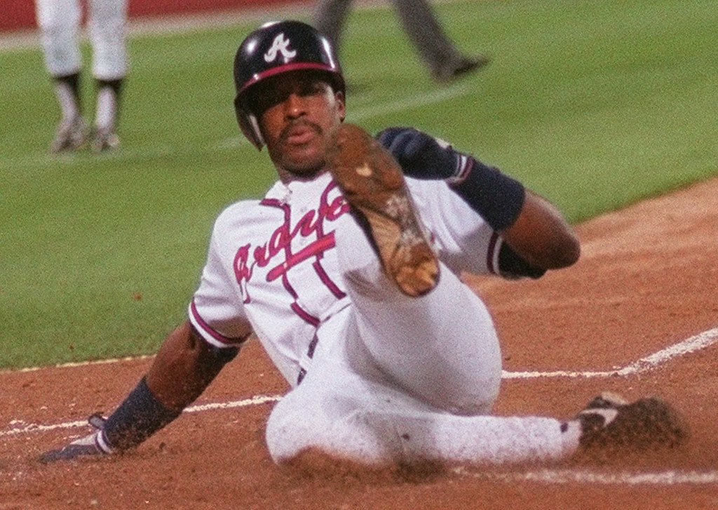 . FRED McGRIFF -- Atlanta Braves Fred McGriff is all alone as he slides home to score on a second inning sacrifice fly by Jermaine Dye in Game 6 of the National League Championship Series against the St. Louis Cardinals in Atlanta on Oct. 16, 1996. (AP Photo/John Bazemore)