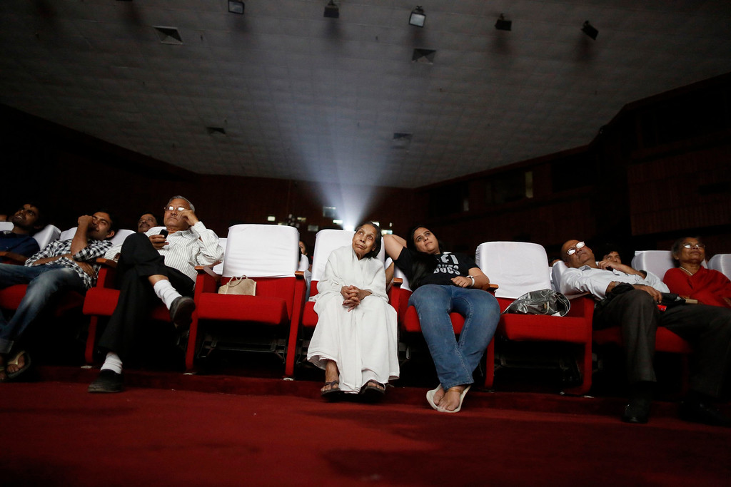 """. An audience watches a Hindi movie being screened during a festival celebrating 100 years of Indian cinema in New Delhi April 30, 2013. Indian cinema marks 100 years since Dhundiraj Govind Phalke\'s black-and-white silent film \""""Raja Harishchandra\"""" (King Harishchandra) held audiences spellbound at its first public screening on May 3, 1913, in Mumbai. Indian cinema, with its subset of Bollywood for Hindi-language films, is now a billion-dollar industry that makes more than a thousand films a year in several languages. It is worth 112.4 billion rupees (over $2 billion) and leads the world in terms of films produced and tickets sold. Picture taken April 30, 2013. REUTERS/Anindito Mukherjee"""
