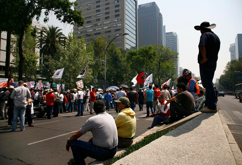 ". Demonstrators protest outside the U.S. embassy before the arrival of President Barack Obama in Mexico City, Thursday, May 2, 2013. The protesters are from an organization that represents people who used to be part of a workers program between Mexico and the U.S. called ""Braceros,\"" members of the Mexican Union of Electricians (SME) and pro-migrant groups.  (AP Photo/Marco Ugarte)"