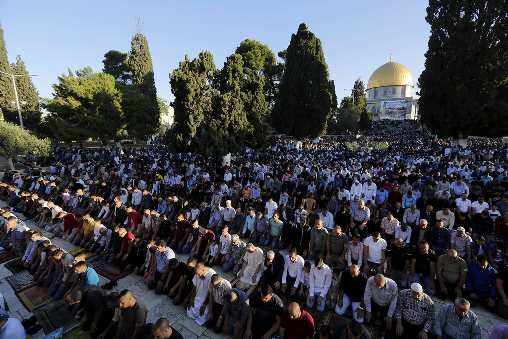 . Palestinians pray in front of the Dome of the Rock shrine in Jerusalem, Friday, June 15, 2018 during the traditional morning prayer of the Muslim holiday of Eid al-Fitr. (AP Photo/Mahmoud Illean)