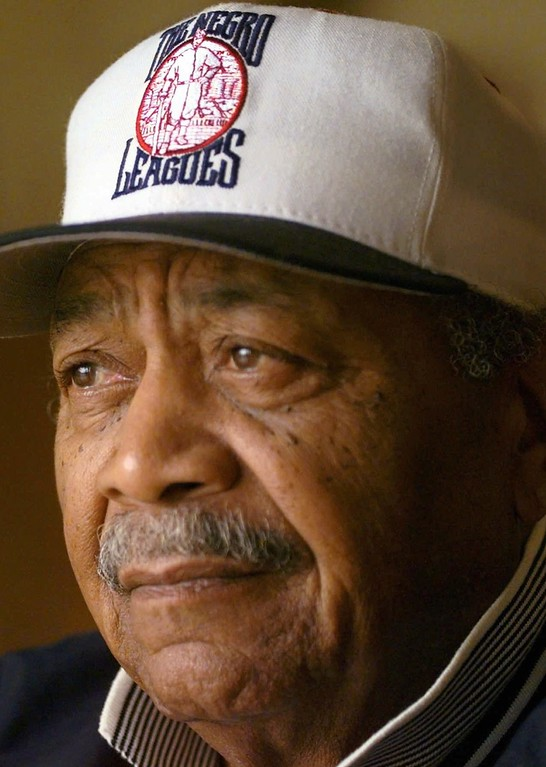 . Larry Doby pauses before a news conference after learning he has been elected to the Baseball Hall of Fame Tuesday, March 3, 1998 in Torrance, Calif. Doby was the second black man to play major league  baseball. (AP Photo/Susan Sterner)