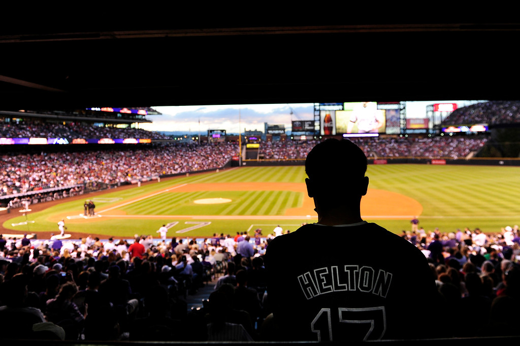. A fan wears a Todd Helton shirt before the start of action in Denver. The Colorado Rockies hosted the Boston Red Sox and said farewell to longtime first baseman Todd Helton, who recently announced his retirement following this season. (Photo by AAron Ontiveroz/The Denver Post)