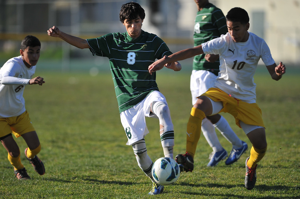 . 2/13/13 - L-R Sergio Rivera of Narboone High School battles for the ball against  Diego Rodriguez of Kennedy during the L.A. City Section Division I playoffs. Narbonne won 1-0. Photo by Brittany Murray / Staff Photographer