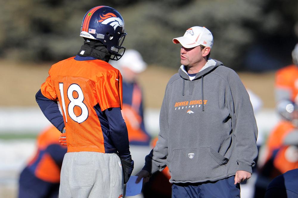 . Denver Broncos quarterback Peyton Manning (18) talks with quarterbacks coach Adam Gase during practice Wednesday, January 2, 2013 at Dove Valley.  John Leyba, The Denver Post