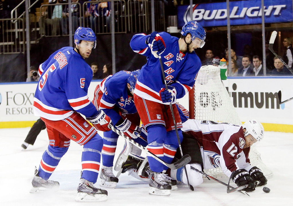 . Colorado Avalanche\'s Jarome Iginla (12) falls down as New York Rangers\' Derick Brassard (16) defends during the first period of an NHL hockey game Thursday, Nov. 13, 2014, in New York. (AP Photo/Frank Franklin II)