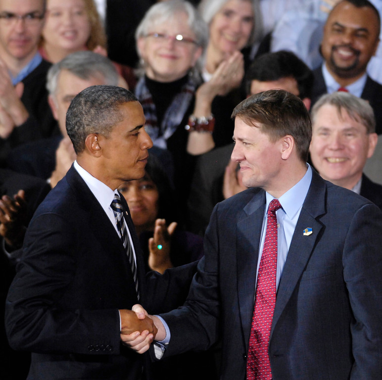 . President Barack Obama shakes hands with former Ohio Attorney General Richard Cordray at Shaker Heights High School after Obama announced he was installing  Cordray as director of the Consumer Finance Protection Bureau in January 2012. (News-Herald file)
