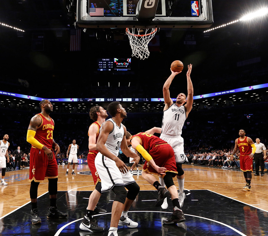 . Brooklyn Nets center Brook Lopez (11) takes a shot in the first half of an NBA basketball game, Wednesday, Jan. 20, 2016, in New York. The Cavaliers defeated the Nets 91-78. (AP Photo/Kathy Willens)