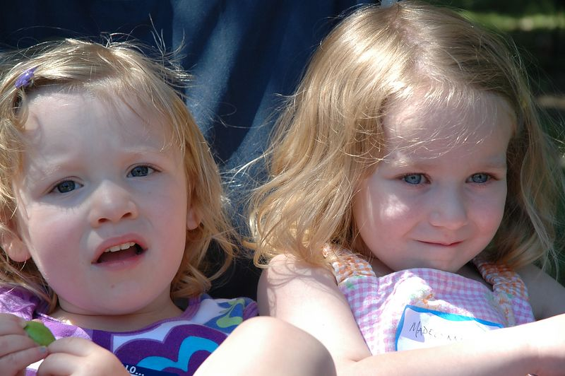 Mary and Madelynne watch the softball game.