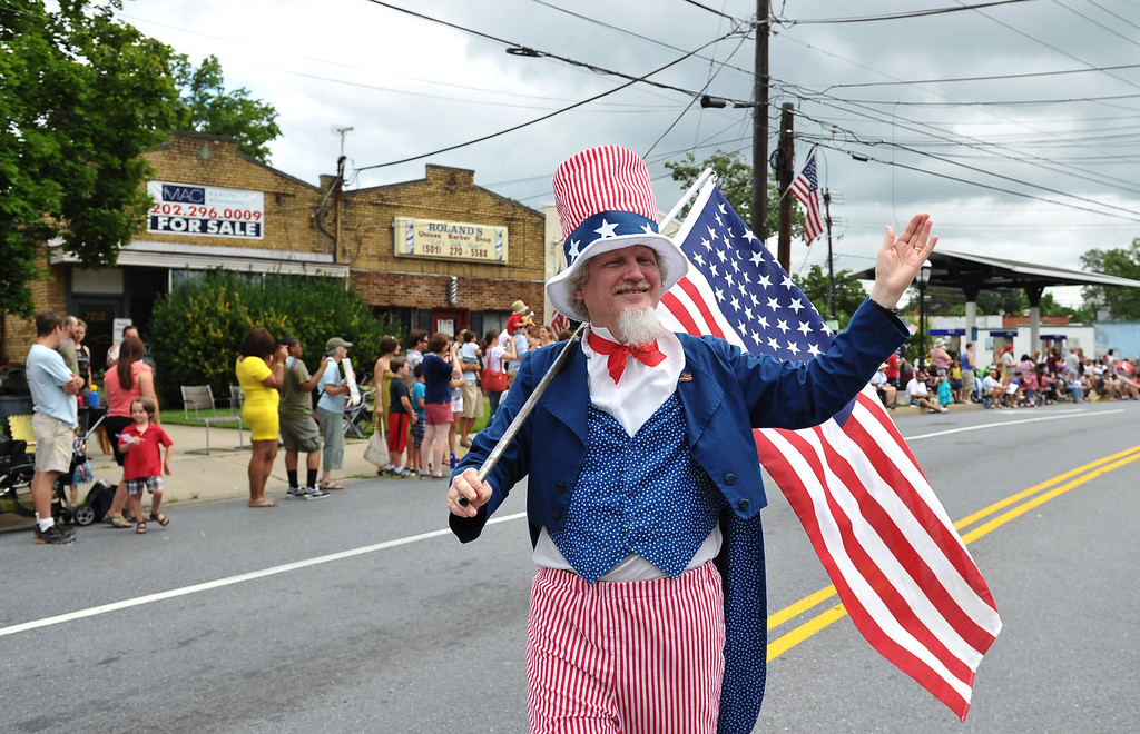 . A man dressed as Uncle Sam takes part in the Independence Day parade in Takoma Park, Maryland on July 4, 2013. Independence Day celebrates the declaration of independence from Britain in 1776. MANDEL NGAN/AFP/Getty Images