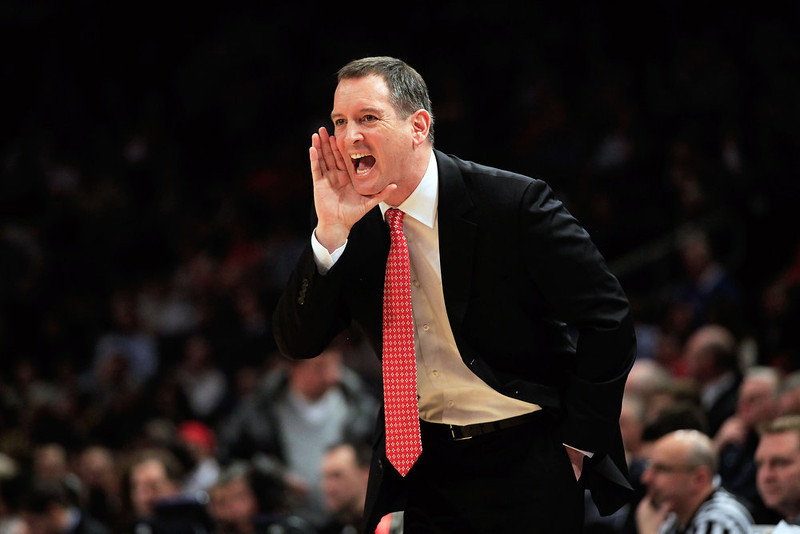 . Head coach Mike Rice of the Rutgers Scarlet Knights coaches from the sideline against the Villanova Wildcats during their first round game of the 2012 BIG EAST Men\'s Basketball Tournament at Madison Square Garden on March 6, 2012 in New York City.  (Photo by Chris Trotman/Getty Images)