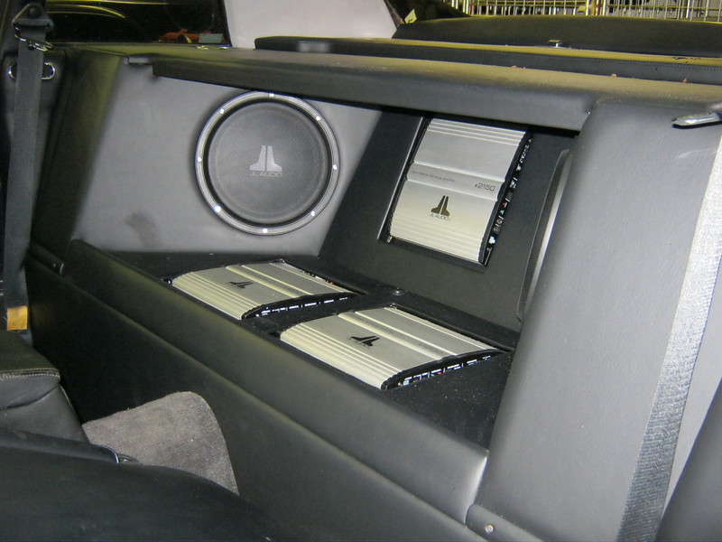Heavily customised, leather-trimmed rear enclosure for amplifiers and rear speakers/subwoofers