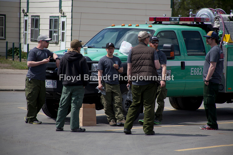 Havre Daily News/Floyd Brandt  U.S. Forestry Fire Fighters stop at Gary & Leo's for lunch Monday Fire Fighters on a long trip from Kalissell to Minnasota to help in a prescribed burning stopprd for a quicl bite to eat on theur long trip at IGA Grocery Store.