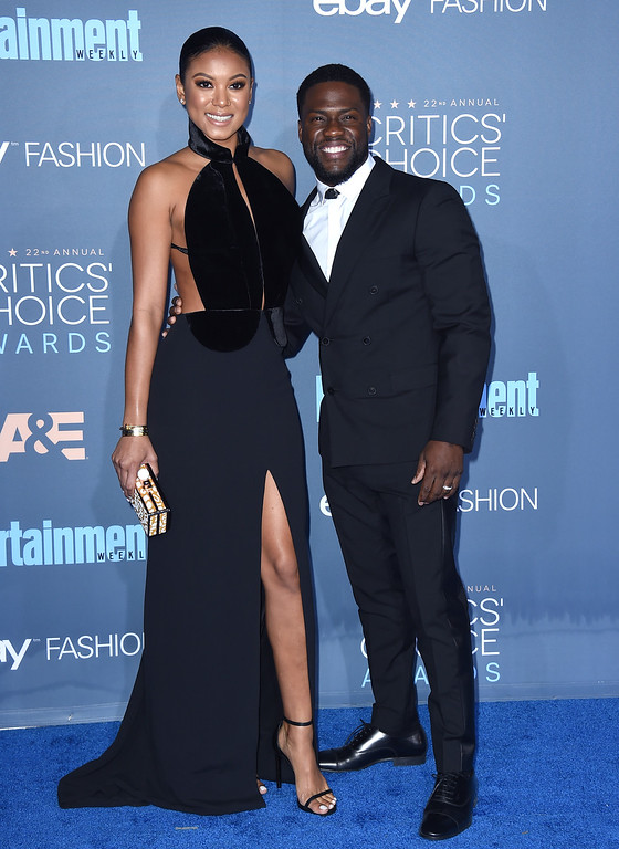 . Kevin Hart, right, and Eniko Parrish arrive at the 22nd annual Critics\' Choice Awards at the Barker Hangar on Sunday, Dec. 11, 2016, in Santa Monica, Calif. (Photo by Jordan Strauss/Invision/AP)