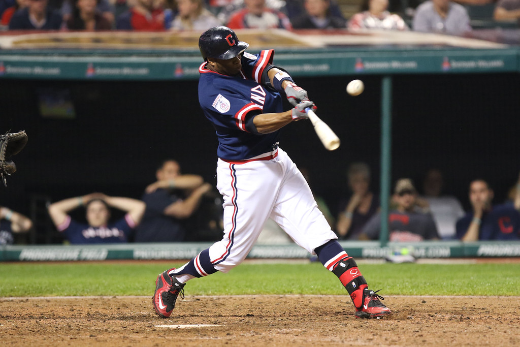 . Tim Phillis - The News-Herald Rajai Davis hits an RBI single during the Indians\' game agains the Kansas City Royals one June 4 at Progressive Field.