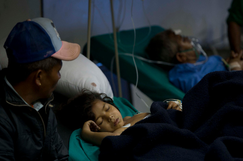 . A young Nepalese girl injured in earthquake lies at a hospital ,in Kathmandu, Nepal, Sunday, April 26, 2015. A strong magnitude 7.8 earthquake shook Nepal\'s capital and the densely populated Kathmandu Valley before noon Saturday, causing extensive damage with toppled walls and collapsed buildings, officials said. (AP Photo/Manish Swarup)