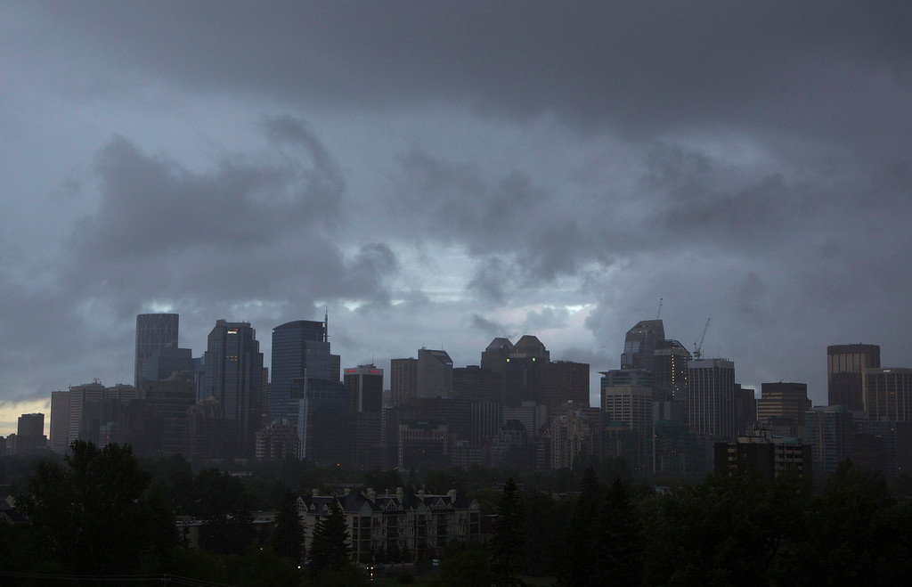. Rains pours down as clouds cover the city of Calgary, Alberta June 20, 2013. The city announced emergency evacuation orders for parts of downtown Calgary with more rain in the forecast and rapidly rising rivers. Many communities across southern Alberta are on mandatory evacuation orders. More than 100,000 people could be evacuated tonight, according to local media. REUTERS/Todd Korol