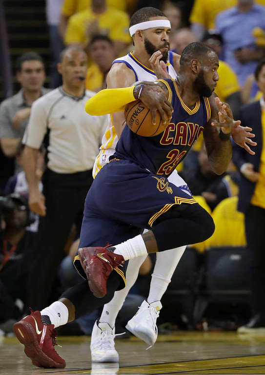 . Cleveland Cavaliers forward LeBron James (23) drives on Golden State Warriors center JaVale McGee during the first half of Game 1 of basketball\'s NBA Finals in Oakland, Calif., Thursday, June 1, 2017. (AP Photo/Marcio Jose Sanchez)