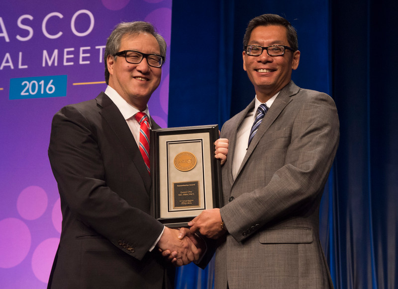 Quyen Chu, MD, MBA, FACS, accepting the Humanitarian Award during Opening Session