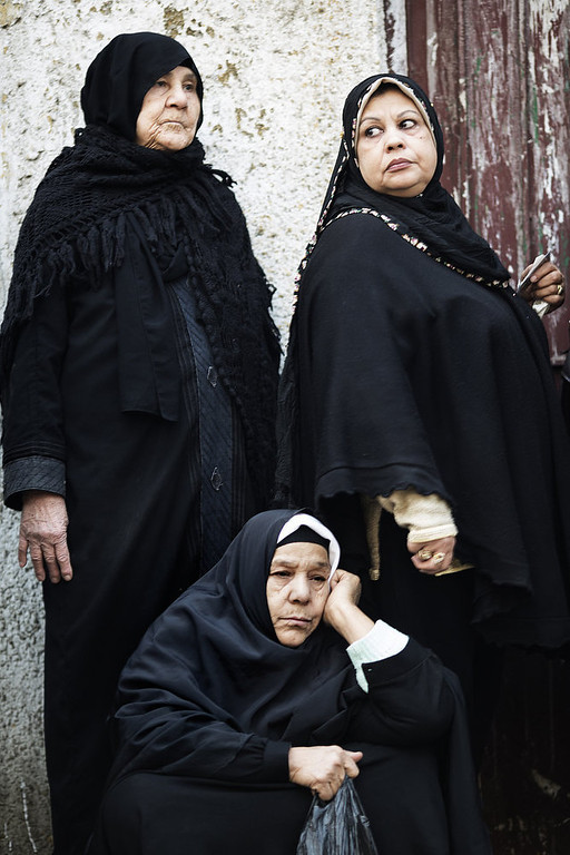 . Egyptian women wait outside a polling station to cast their votes on a new constitution supported by the ruling Islamists but bitterly contested by a secular-leaning opposition on December 15, 2012 in Cairo. President Mohamed Morsi cast his ballot in a polling station close to his presidential palace in the capital, state television showed, but he made no comment to the media. MARCO LONGARI/AFP/Getty Images
