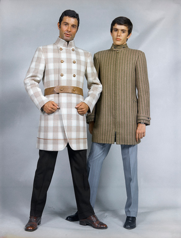 . Two sports jackets by Angelo Litrico of Rome in 1968. One long, Double Breasted of brown and white wool. The other is long, of vertically striped green and brown wool, with a hidden zipper, and Mao Collar. (AP Photo)