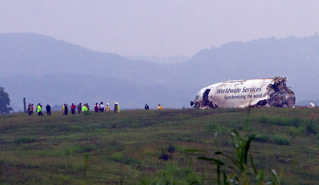 . A UPS cargo plane lies on a hill at Birmingham-Shuttlesworth International Airport after crashing on approach, Wednesday, Aug. 14,  2013, in Birmingham, Ala.  (AP Photo/Butch Dill)
