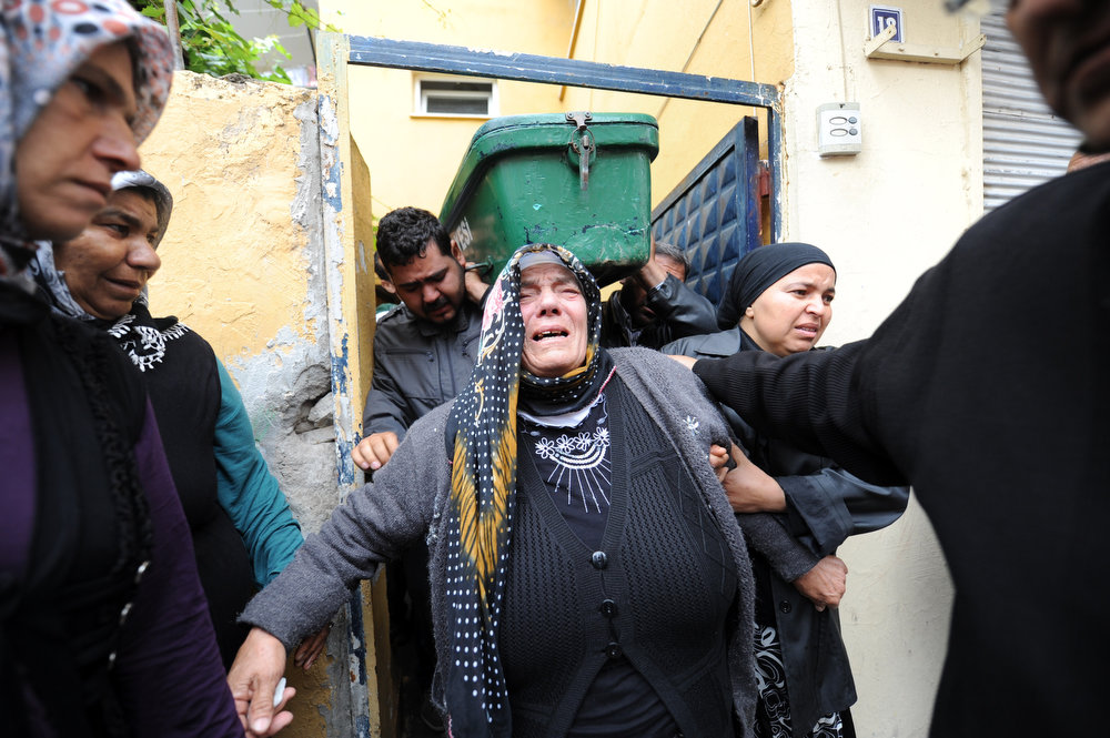 . Relatives mourn as they carry the coffin of Ogulcan Tuna, 18 year, on May 12, 2013 during the funerals of the victims of a car bomb which went off on May 11 at Reyhanli in Hatay just a few kilometers from the main border crossing into Syria. Turkey was reeling from twin car bomb attacks which left at least 43 people dead in a town near the Syrian border, with Ankara blaming pro-Damascus groups and vowing to bring the perpetrators to justice. A Syrian minister denied on May 12 accusations that Damascus was behind a bomb attack in a Turkish town that left dozens dead, a day after Ankara blamed supporters of President Bashar al-Assad for the blasts.   BULENT KILIC/AFP/Getty Images