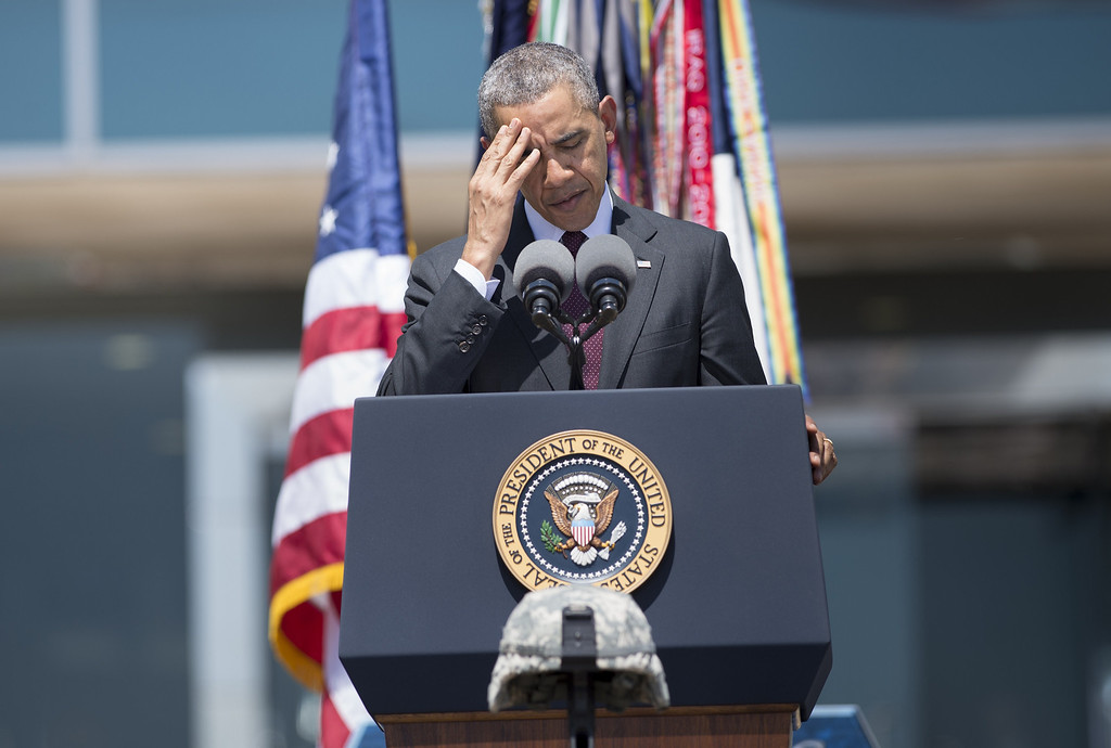 . US President Barack Obama pauses while speaking during a memorial service at Fort Hood on April 9, 2014 in Texas.  AFP PHOTO/Brendan  SMIALOWSKI/AFP/Getty Images