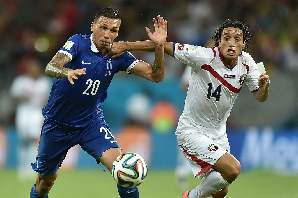 . Greece\'s defender Jose Holebas (L) vies with Costa Rica\'s forward Randall Brenes, during a Round of 16 football match between Costa Rica and Greece at Pernambuco Arena in Recife during the 2014 FIFA World Cup on June 29, 2014.   SARIS MESSINIS/AFP/Getty Images