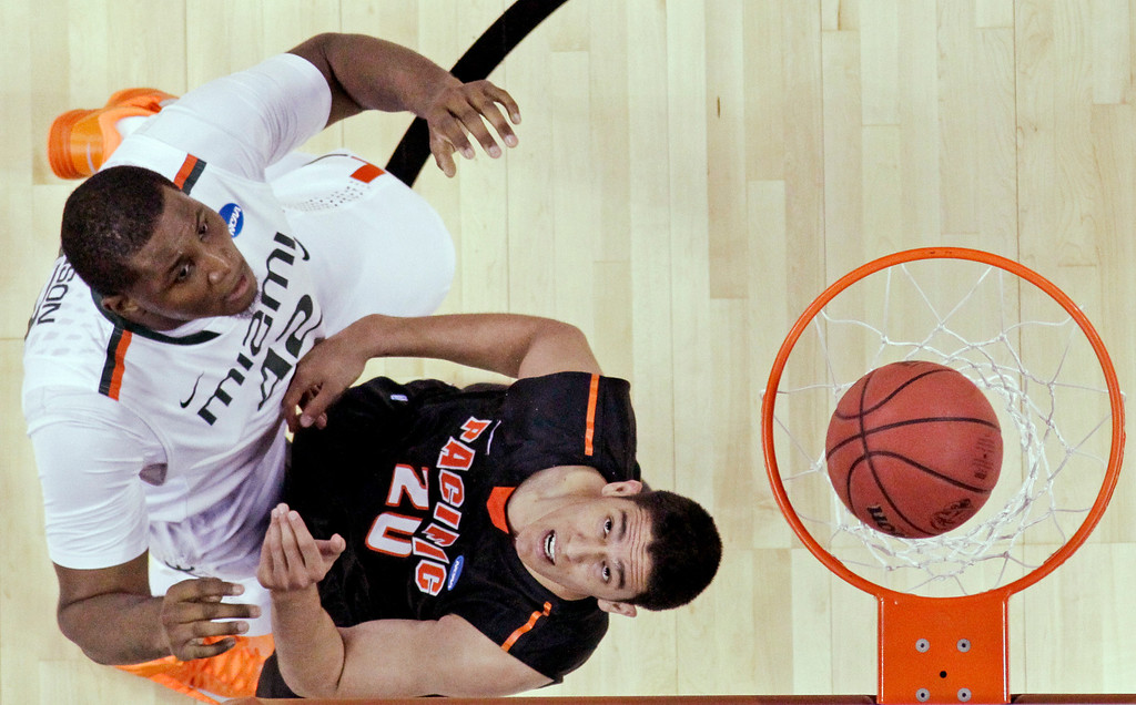 . Miami\'s Reggie Johnson (42) shoots over Pacific\'s Ross Rivera (20) during the second half of a second-round game of the NCAA college basketball tournament Friday, March 22, 2013, in Austin, Texas.  (AP Photo/David J. Phillip)