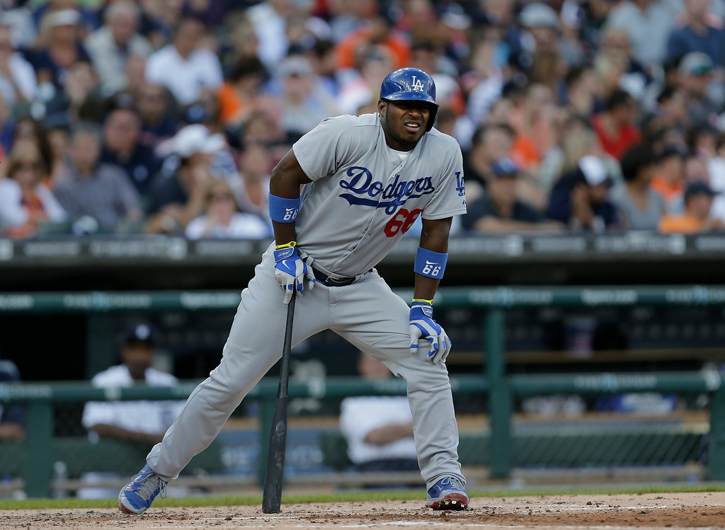 . Los Angeles Dodgers\' Yasiel Puig bats against the Detroit Tigers in the second inning of a baseball game in Detroit, Tuesday, July 8, 2014. (AP Photo/Paul Sancya)